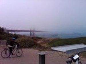 The Golden Gate Bridge winks through the fog.