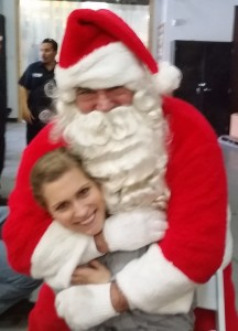 Santa gives a fan a hug